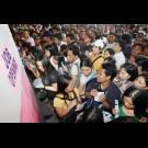 Job seekers lining up in a job fair